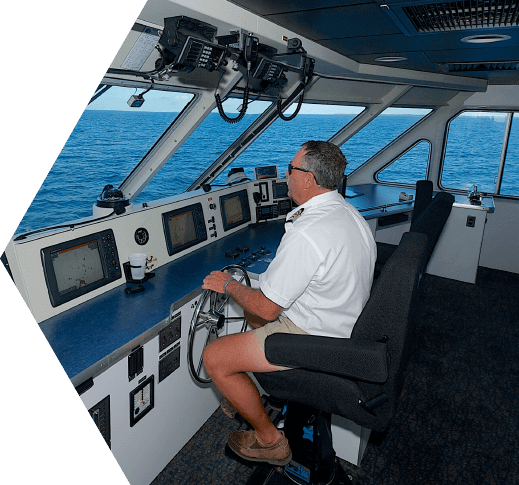 The captain of the Yankee Freedom III on the bridge steering the catamaran towards the Dry Tortugas