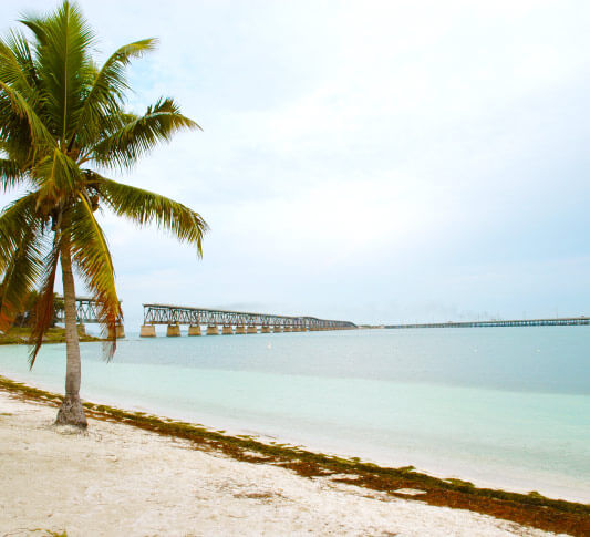 A distant view of the Bahia Honda Rail Bridge from the sand of Bahia Honda Beach in Key West