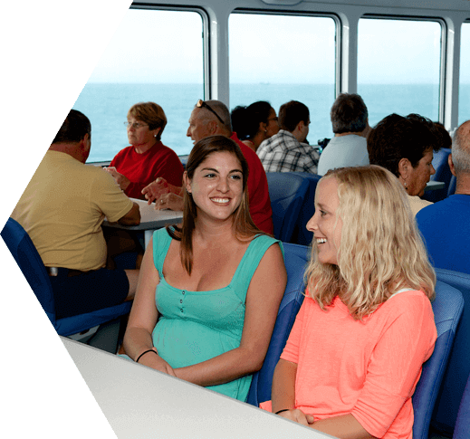 Two women conversing aboard the Yankee Freedom III on the way to the Dry Tortugas